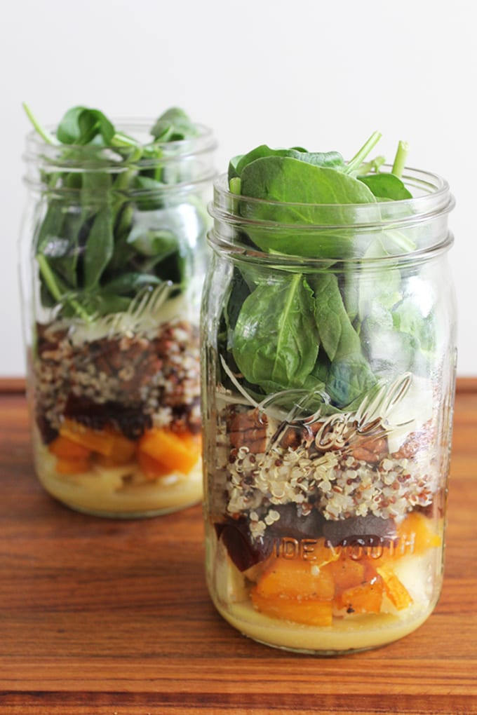 A quick and easy Meatless Monday meal on the go! Get the recipe for this roasted butternut squash and quinoa mason jar salad.   FitLiving Eats