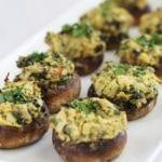 spinach artichoke hummus stuffed mushrooms featured