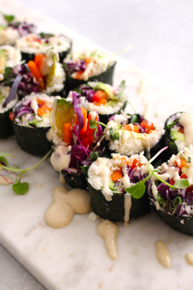 How to make your own homemade vegan sushi rolls + GLOW raw vegan sushi with a miso tahini sauce recipe   FitLiving Eats by Carly Paige