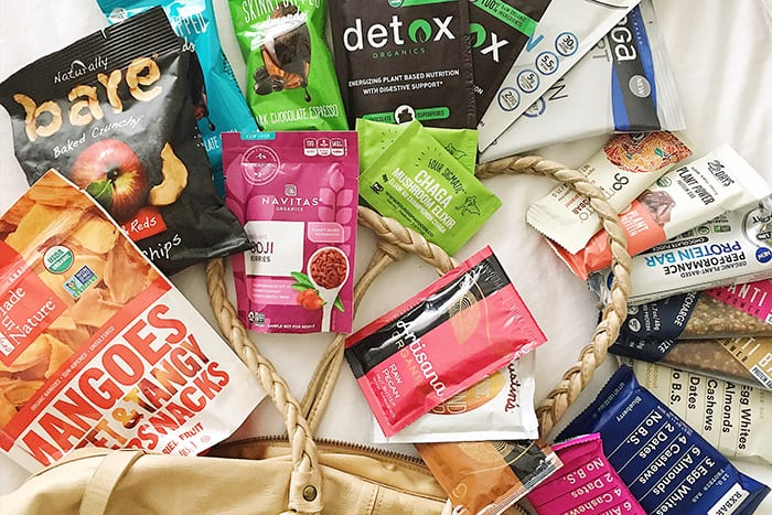 FitLiving Eats by Carly Paige - stay healthy while traveling featured