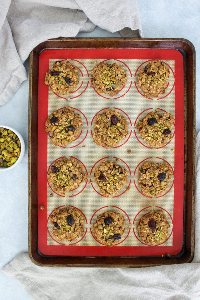 cranberry pistachio oatmeal cookie on baking sheet