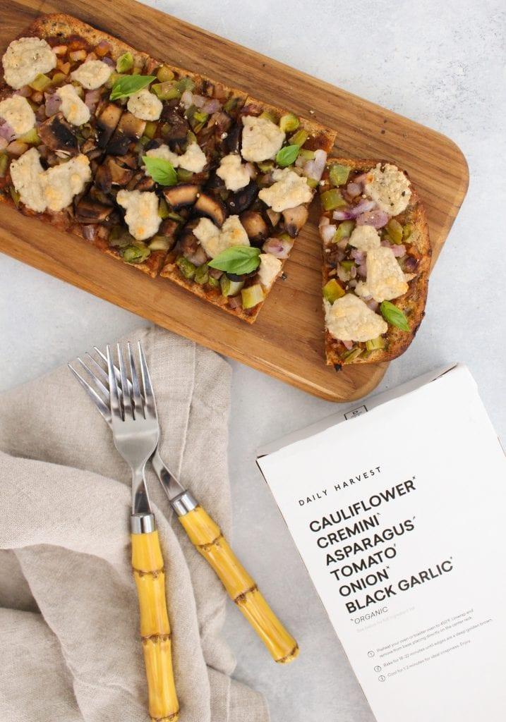 daily harvest flatbread - cauliflower, cremini, asparagus, tomato, onion, black garlic